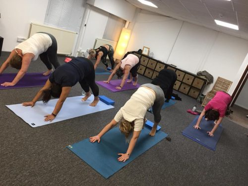 Yoga for arthritis - a Diversity Yoga class practices Downward Facing Dog